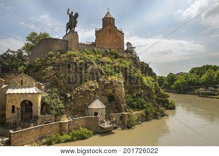 view of the historical district Metekhi, Mtkvari ( Kura )river, Metekhi Church of Assumption and equestrian statue of King Vakhtang Gorgasali in Tbilisi, Georgia