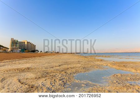 Salt On Shore Of The Dead Sea With Hotels In Ein Bokek
