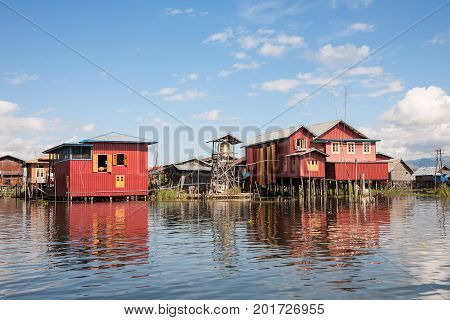 A village with houses on piles on the shores of the Inle Lake in the Shan state in central Burma