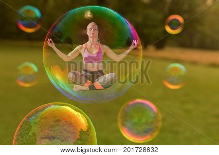 A yoga woman is hovering in a soap bubble (3d mixed media)