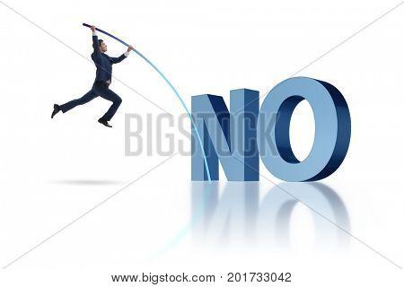 Businessman vaulting over word no