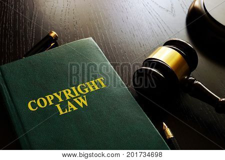 Copyright law and gavel on a table.