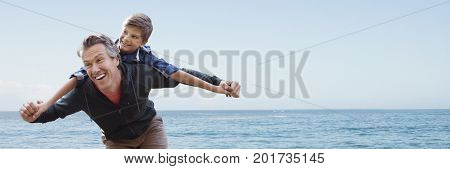 Digital composite of Son on father's back against horizon