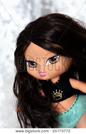 Toy doll with big eyes and long hair