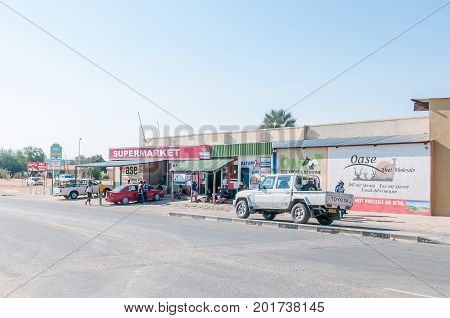 KAMANJAB NAMIBIA - JUNE 27 2017: A street scene with businesses and vehicles in Kamanjab a small town in the Kunene Region of Namibia