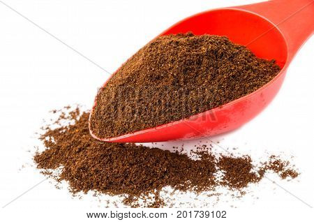 Ground Coffee In Red Spoon And Heap Of Coffee