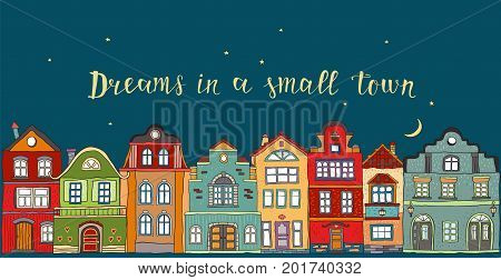 Row of houses in a small Scandinavian city at night.Vector doodles.Inscription dreams in a small town