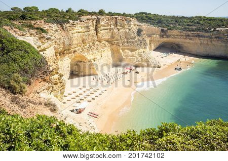 Beach ready to relax tourists at Praia da Marinha Portugal Algarve, Private beach for tourists, Sheltered sand beach by sea, Beautiful beach with boat