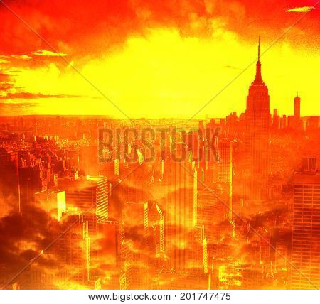 Awerial view of Manhattan with Empire State Building in red and yollow tones.