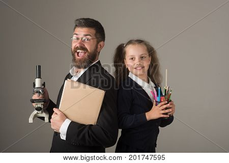 Girl And Man In Suit And School Uniform