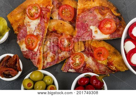 Sourdough Pizza Slate platter with a Pork Salami Sourdough Pizza, and side dishes