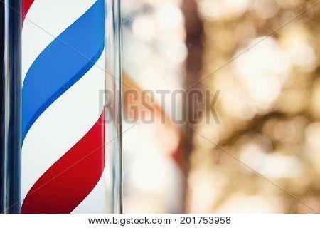 Barber shop pole on the window. copyspace