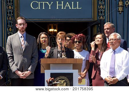 San Francisco CA - August 25 2017: Congress woman Jackie Speier speaks to the crowd at the Unite Against Hate rally at Civic Center in front of City Hall in San Francisco.