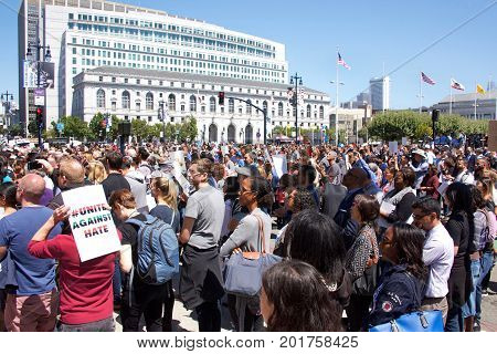 San Francisco CA - August 25 2017: Hundreds of people gathered in support of the Unite Against Hate rally held at Civic Center infront of City Hall where the Mayor and city leaders spoke out against hate.