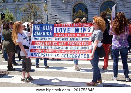 San Francisco CA - August 25 2017: Unite Against Hate rally preparing to begin the crowd gathers to hear the Mayor city and religious leaders speak out against hate in the City of San Francisco.