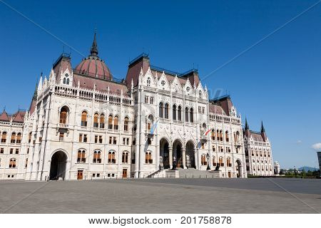 The facade of the immense white marble building of the neo-gothic Hungarian Parliament in Budapest the capital of Hungary