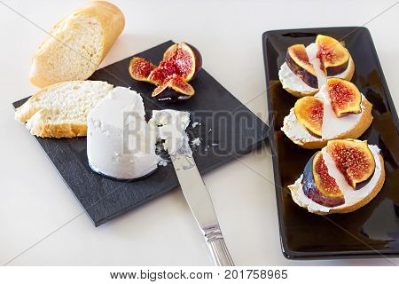 Goat Cheese, Baguette And Fig On Slate Board. Toast Bruschetta With Fresh Fig, Goat Cheese On Black