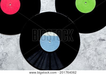 records in music studio for dj or musician work on stone desk background top view