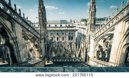 The roof of the Milan Cathedral (Duomo di Milano) in Milan, Italy. Milan Duomo is the largest church in Italy and the fifth largest in the world. 16:9 widescreen.