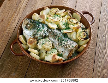 Psari sto fourno.baked fish. Cypriot cuisine close up cooking meal