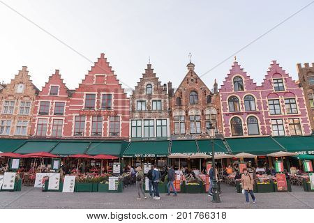 Shops And Restaurants Around The Market Place - Grote Markt In Bruges, Belgium.