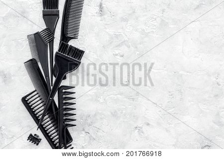 beauty salon black work tools with comb for hair dress and coloring on stone desk background top view mock up
