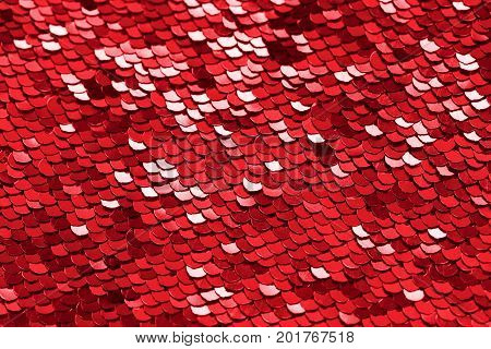 Red sequins background or texture. Sparkling sequined textile
