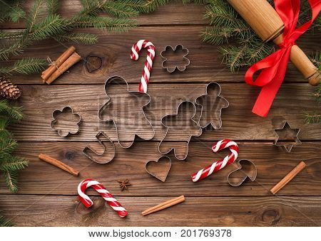 Baking Christmas cookies. Bakeware. On a wooden background