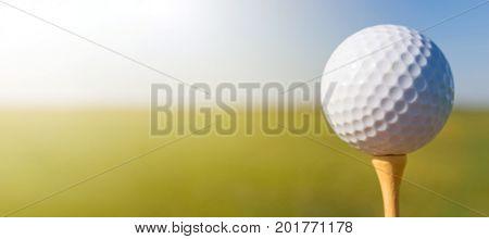 Golf ball on tee. Close up. Golf ball on tee.