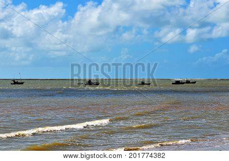 Small trawler in calm sea of Porto Seguro, Bahia, Brazil.