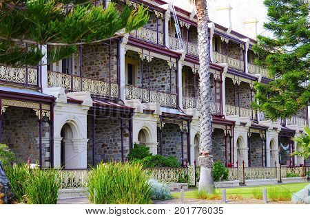 Row Of Victorian Bluestone And Sandstone Three Story Terraces,