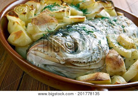 Psari sto fourno.baked fish. Cypriot cuisine  close up   homemade  healthy, meal