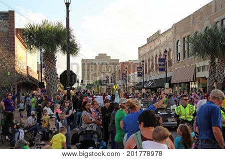 LAKE CHARLES, LA - FEBRUARY 26: Crowds enjoy a festive atmosphere during Mardis Gras celebrations in downtown Lake Charles, Louisiana February 26, 2017 in Lake Charles, Louisiana