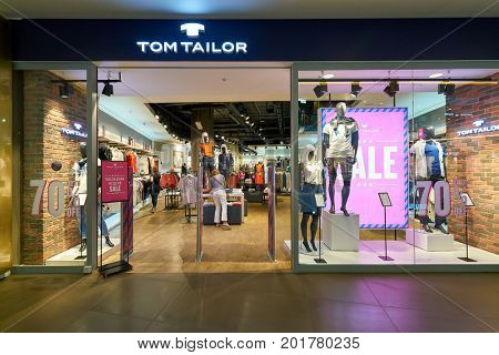 SAINT PETERSBURG, RUSSIA - CIRCA AUGUST, 2017: Tom Tailor store at Galeria shopping center. Tom Tailor is a German lifestyle clothing company.