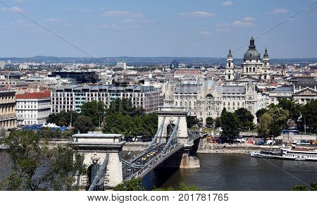Famous Chain Bridge over Danube River and Saint Stephen's Basilica view from Buda Castle on sunny autumn day in Budapest capital city of Hungary Europe. UNESCO World Heritage Site