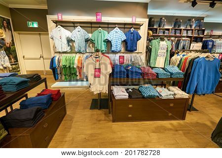 SAINT PETERSBURG, RUSSIA - CIRCA AUGUST, 2017: inside Tom Tailor store at Galeria shopping center. Tom Tailor is a German lifestyle clothing company.