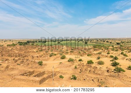 Horizontal picture of Thar Desert with old buildings located close to Jaisalmer the Golden City in India.