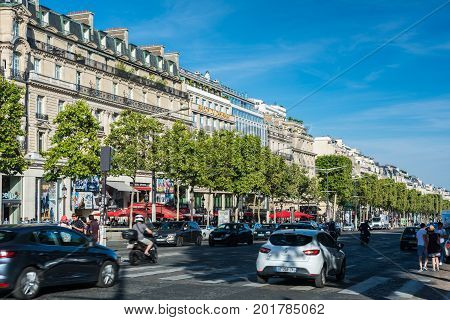 Paris France - August 13 2016: The Avenue des Champs-Elysees is an avenue in the 8th arrondissement of Paris 1.9 kilometres long running between the Place de la Concorde and the Place Charles de Gaulle where the Arc de Triomphe is located