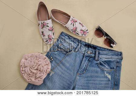Embroidered flowers jeans ,shoes.sunglasses,bag -khaki background