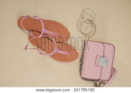 Set of shoes,handbag, bracelt-khaki background