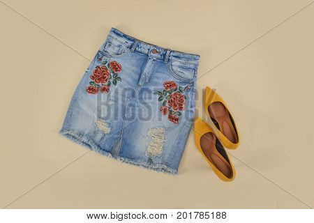 Summer embroidery,floral Jeans skirt ,shoes-khaki background
