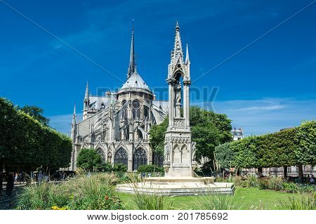 Paris France - August 13 2016: The Cathedral Notre-dame de Paris the Square Jean XXIII and the statue of the virgin. Notre-Dame is a medieval Catholic cathedral on the ile de la Cite in the fourth arrondissement of Paris France.