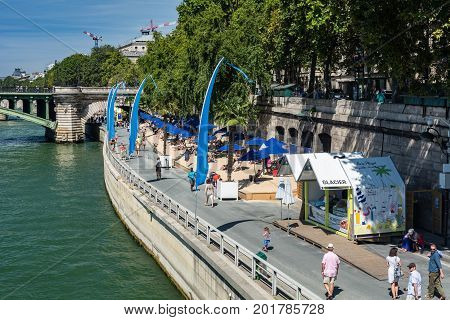 Paris France - August 13 2016: Tourists walking near The Seine in Paris during the event
