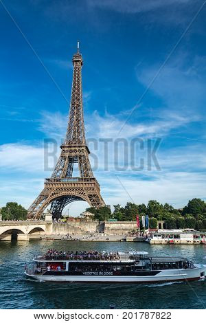 Paris France - August 13 2016: The Eiffel Tower (Tour Eiffel) is a wrought iron lattice tower (324m) on the Champ de Mars in Paris France. It is named after the engineer Gustave Eiffel whose company designed and built the tower.