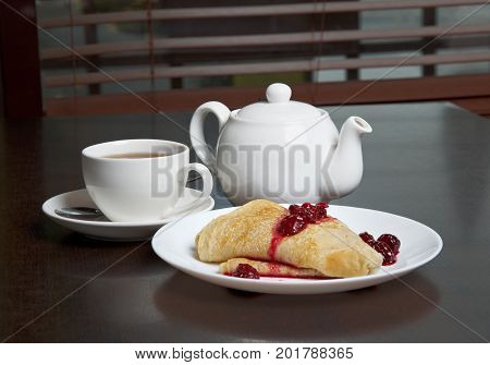Teapot, Cup Of Tea And Pancakes With Cherry Confiture