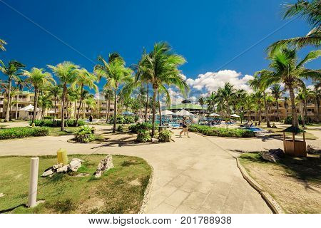 Cayo Coco island, Trip Cayo Coco, Cuba, July 11, 2017, gorgeous, amazing inviting view of hotel grounds, tropical garden and swimming pool with people walking, relaxing and swimming in background