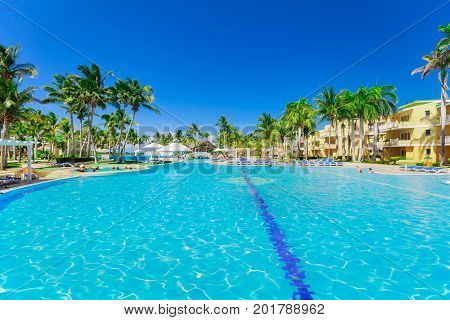 Cayo Coco island, Cuba, Trip Cayo Coco hotel, July , 2017, amazing beautiful inviting view of hotel grounds and people relaxing in swimming pool and enjoying their time on sunny nice day