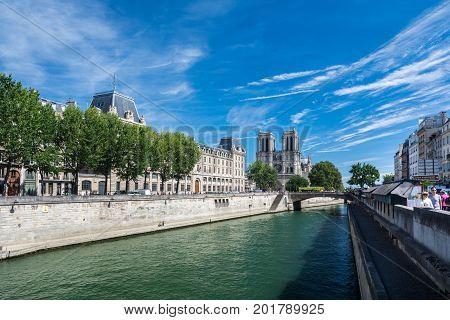 Paris France - August 13 2016: The Cathedral Notre-dame de Paris and the river Seine. Notre-Dame is a medieval Catholic cathedral on the ile de la Cite in the fourth arrondissement of Paris France.
