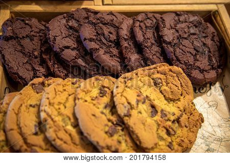 Closeup Of A Group Of Assorted Cookies. Chocolate Chip, Oatmeal Raisin, White Chocolate Fill The Fra