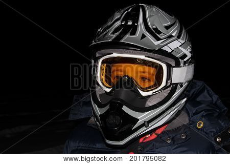 Child Wearing an ATV Helmet at Night.